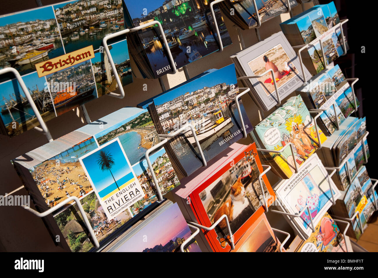 UK, England, Devon, Brixham colourful picture postcards of local views in rack for sale - Stock Image
