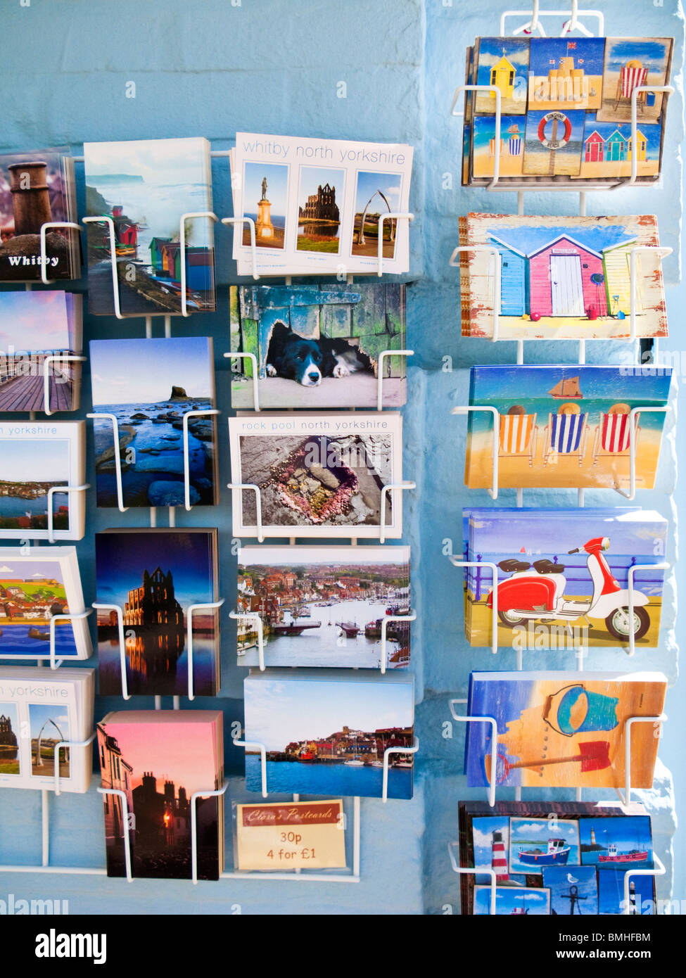 Postcards on a rack at a British seaside resort England UK - Stock Image