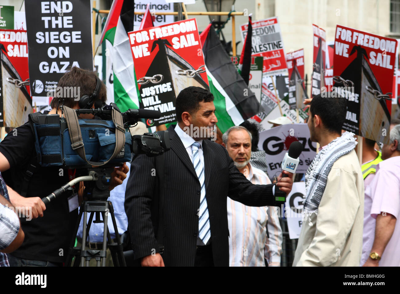 A TV News Reporter at the 'Freedom for Palestine' demonstration on Whitehall, Westminster, London, England, - Stock Image