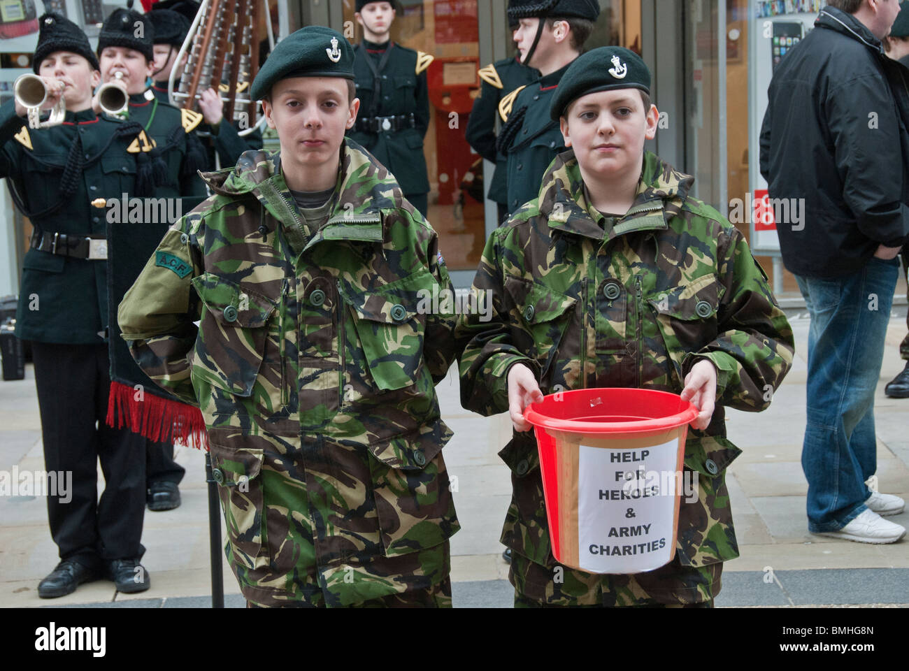 TWO YOUNG ARMY CADET COLLECTING MONEY TO SUPPORT BRITISH ARMY - Stock Image