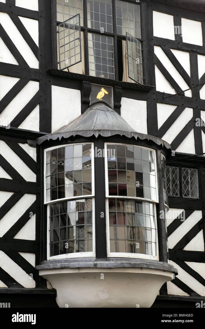 Detail of bay windows on a black & white wattle & daub half timbered building on Broad Street Ludlow Shropshire - Stock Image