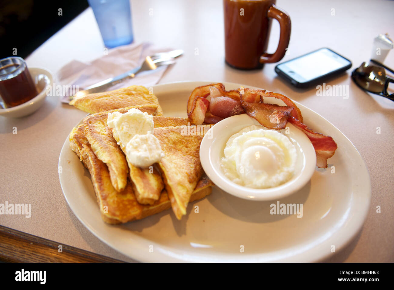 Highway truck stop breakfast. French Toast with bacon and eggs. Off of I-90 interstate highway. , Ellensburg Washing, - Stock Image