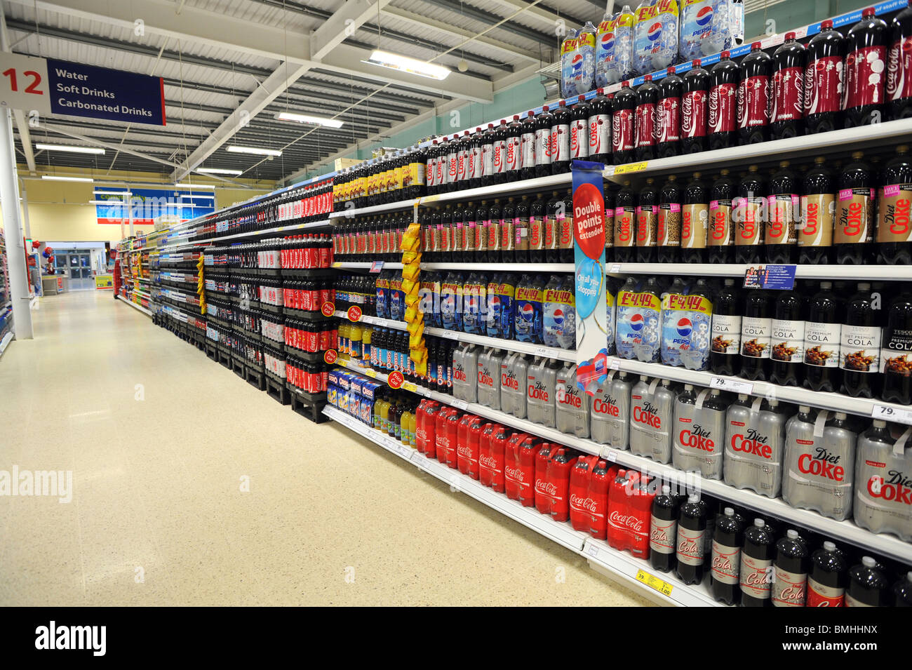 Bottles of different types of coke and soft drinks on sale in Tesco - Stock Image