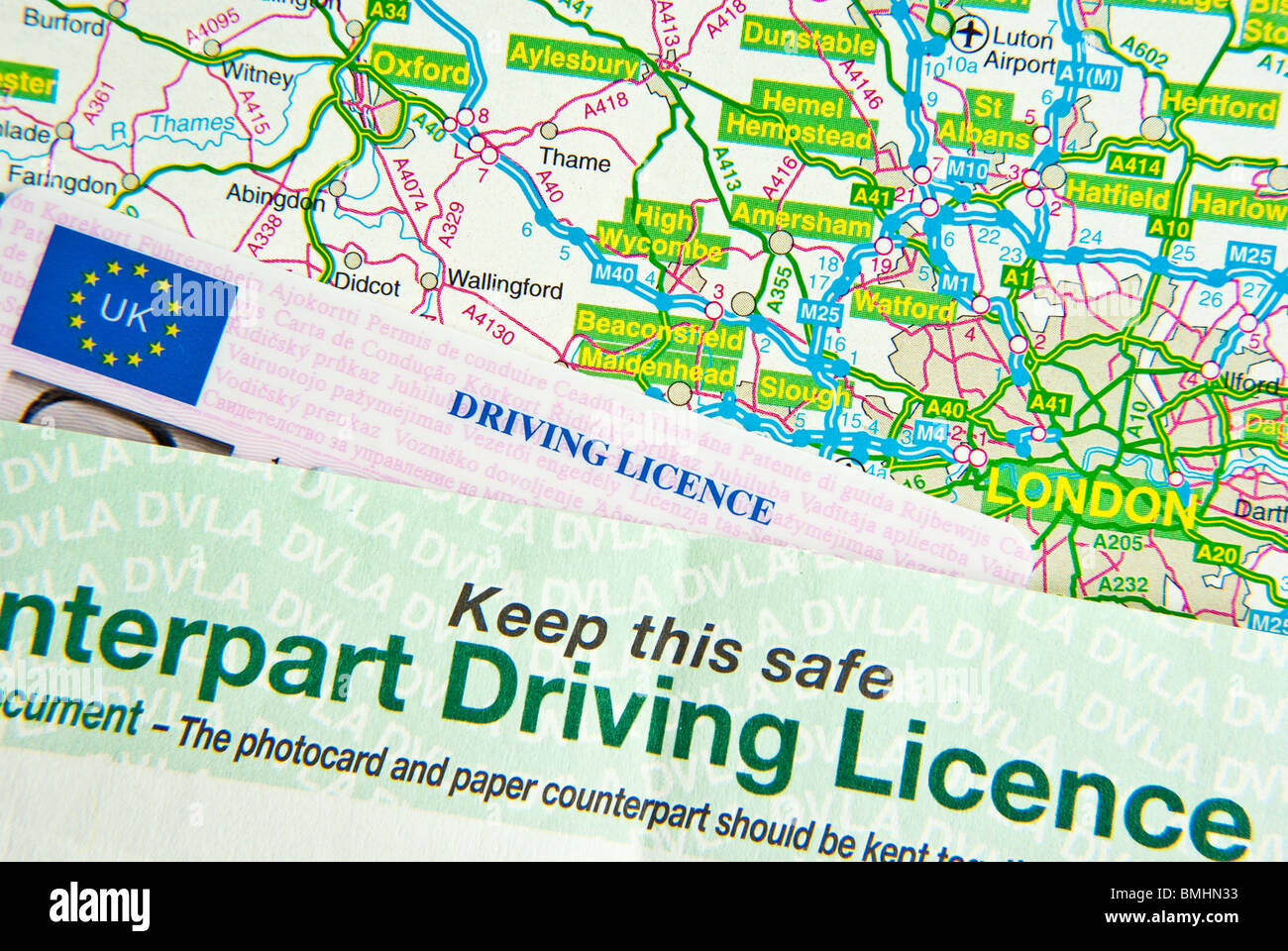 Map Around London.Uk Driving Licence On Uk Road Map Around London Stock Photo