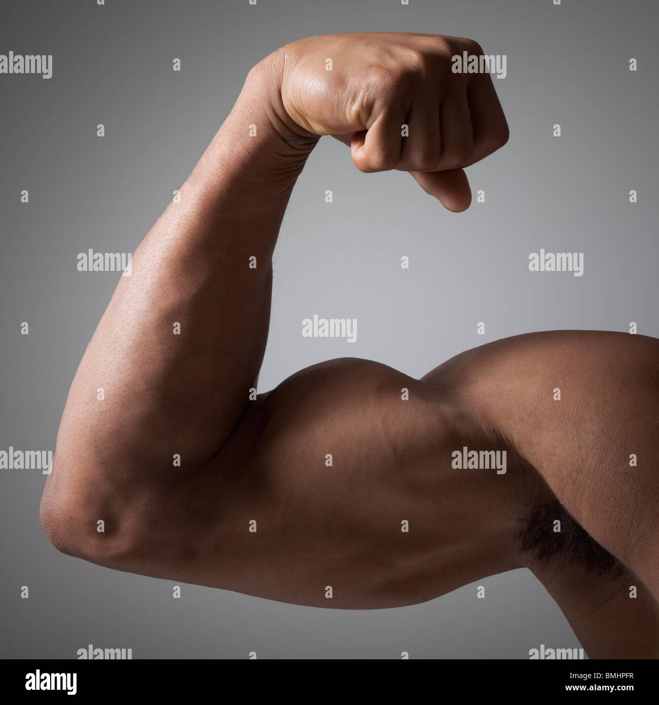 Flexed muscular arm - Stock Image