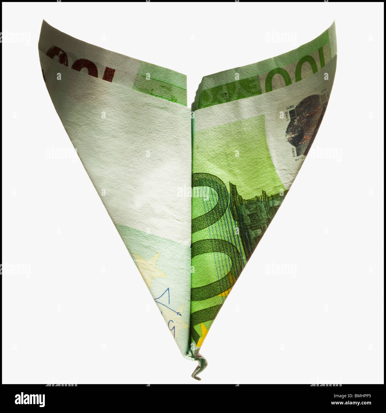 Paper airplane made out of money - Stock Image