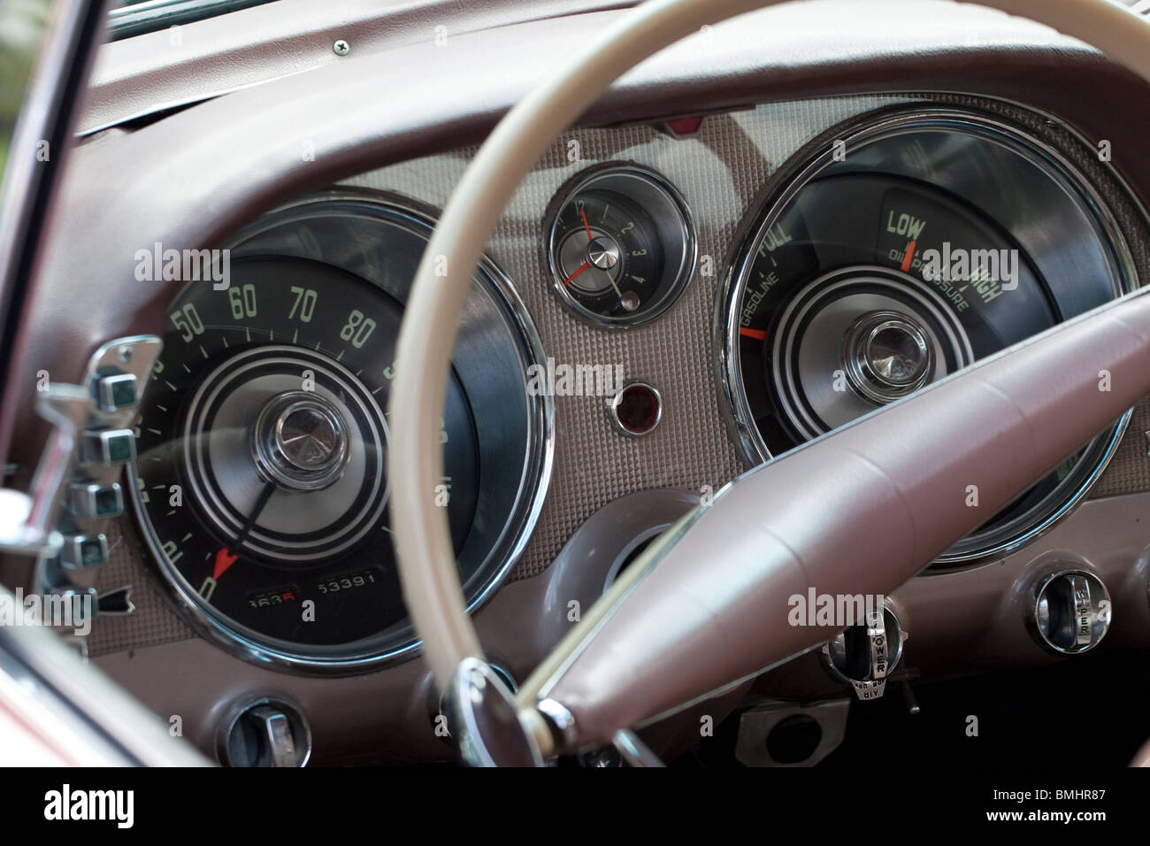 An old classic Cadillac steering wheel showing the speedometer and steering wheel - Stock Image
