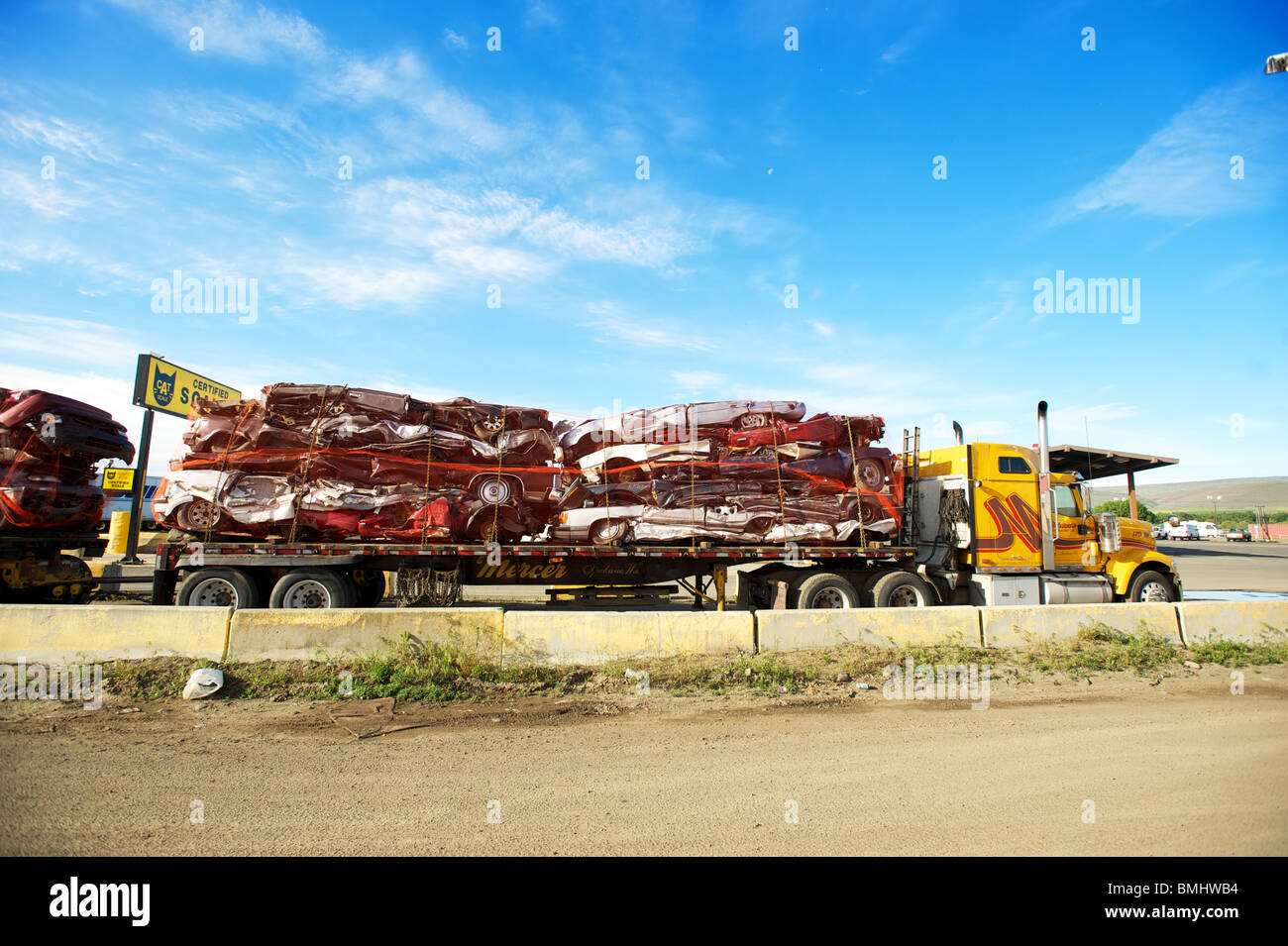 Crushed cars on a truck bed. - Stock Image