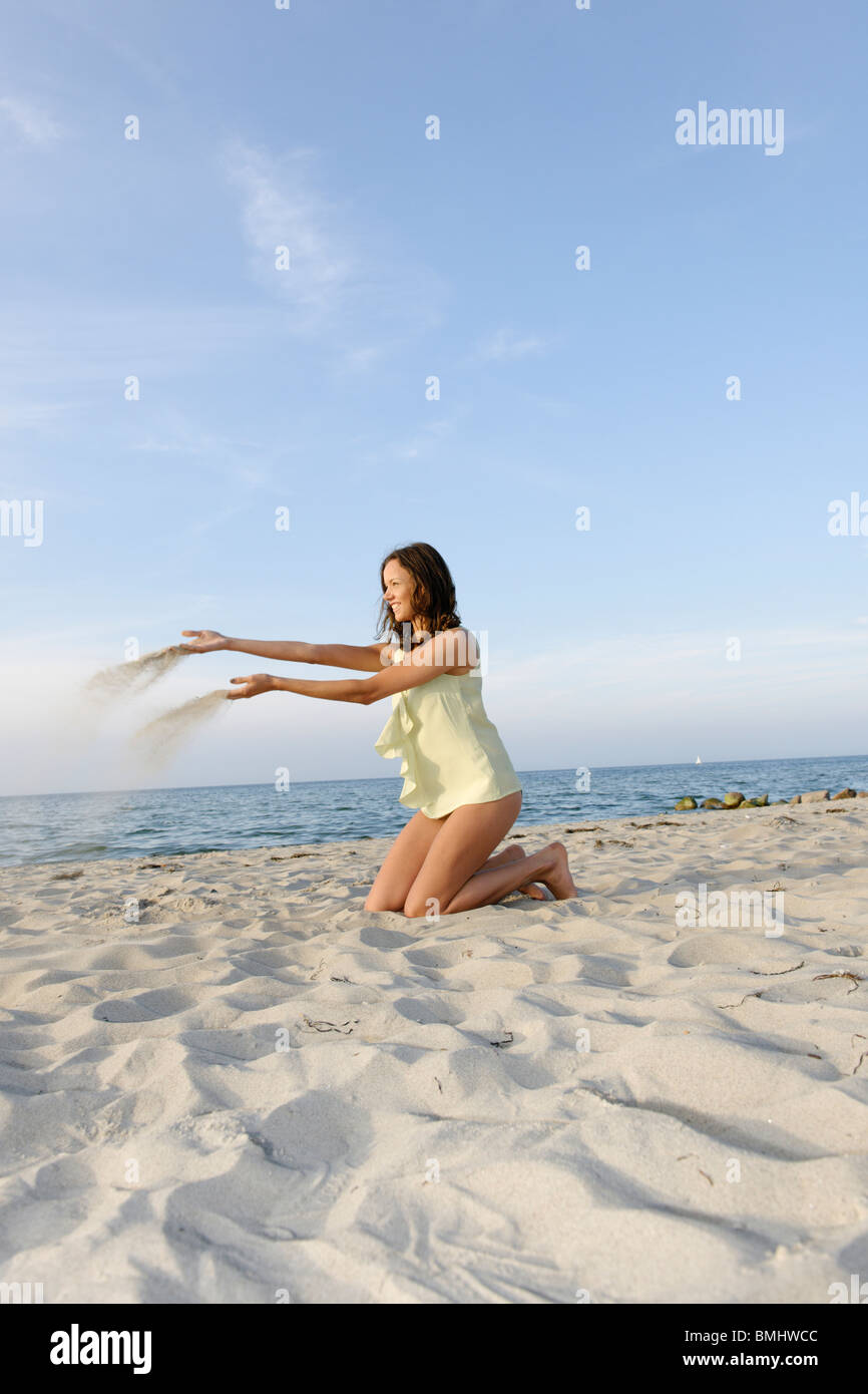 Young woman, 20+, on a beach, fun, lifestyle, pleasure, ease, Niendorf on the Baltic Sea, Schleswig-Holstein, Germany, Europe Stock Photo