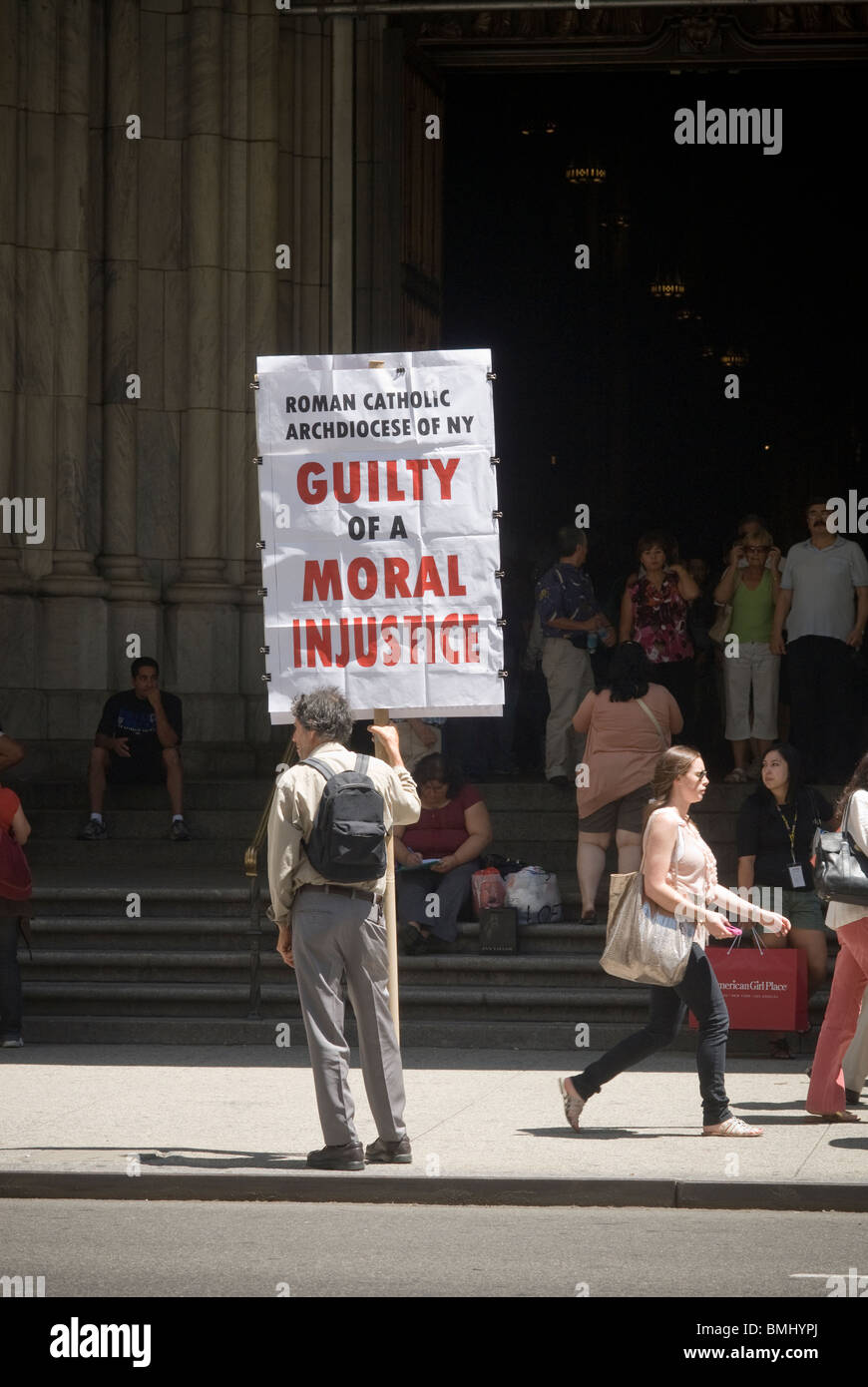 Lone protester outside St. Patrick's Cathedral on Fifth Avenue in New York on Tuesday, June 8, 2010. (© - Stock Image