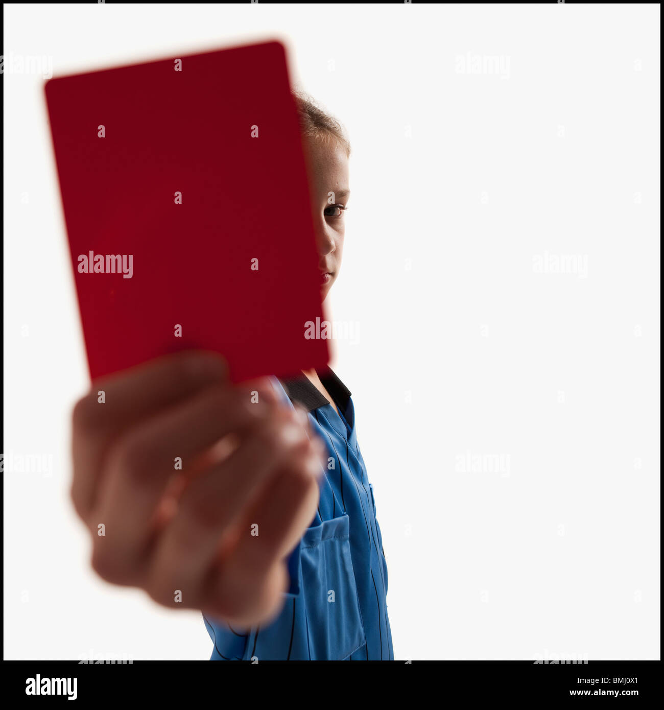 Young girl holding red card - Stock Image