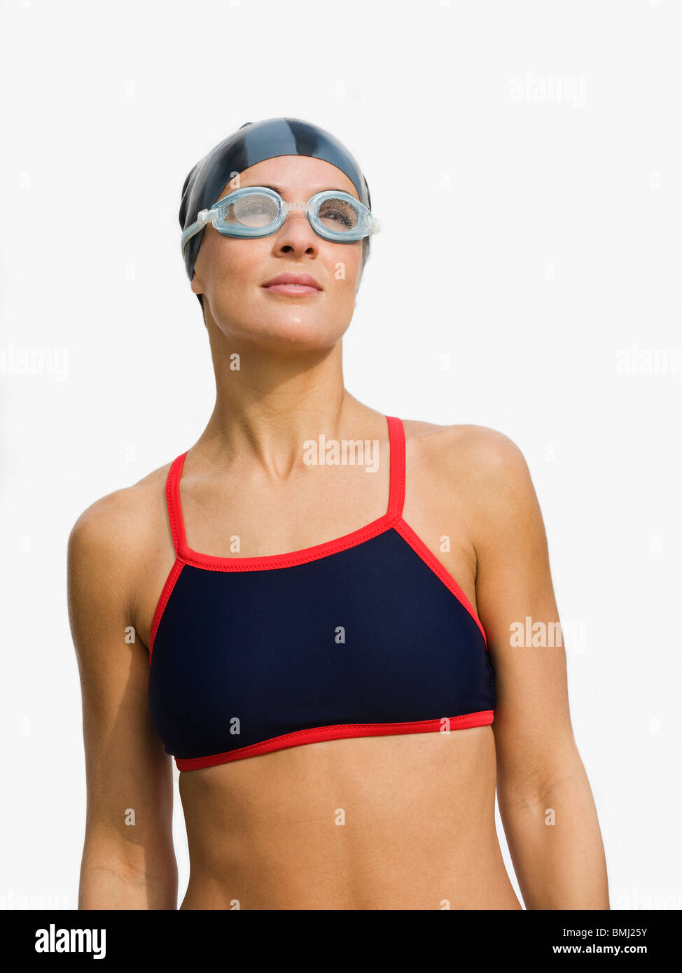 Woman wearing swimming goggles - Stock Image