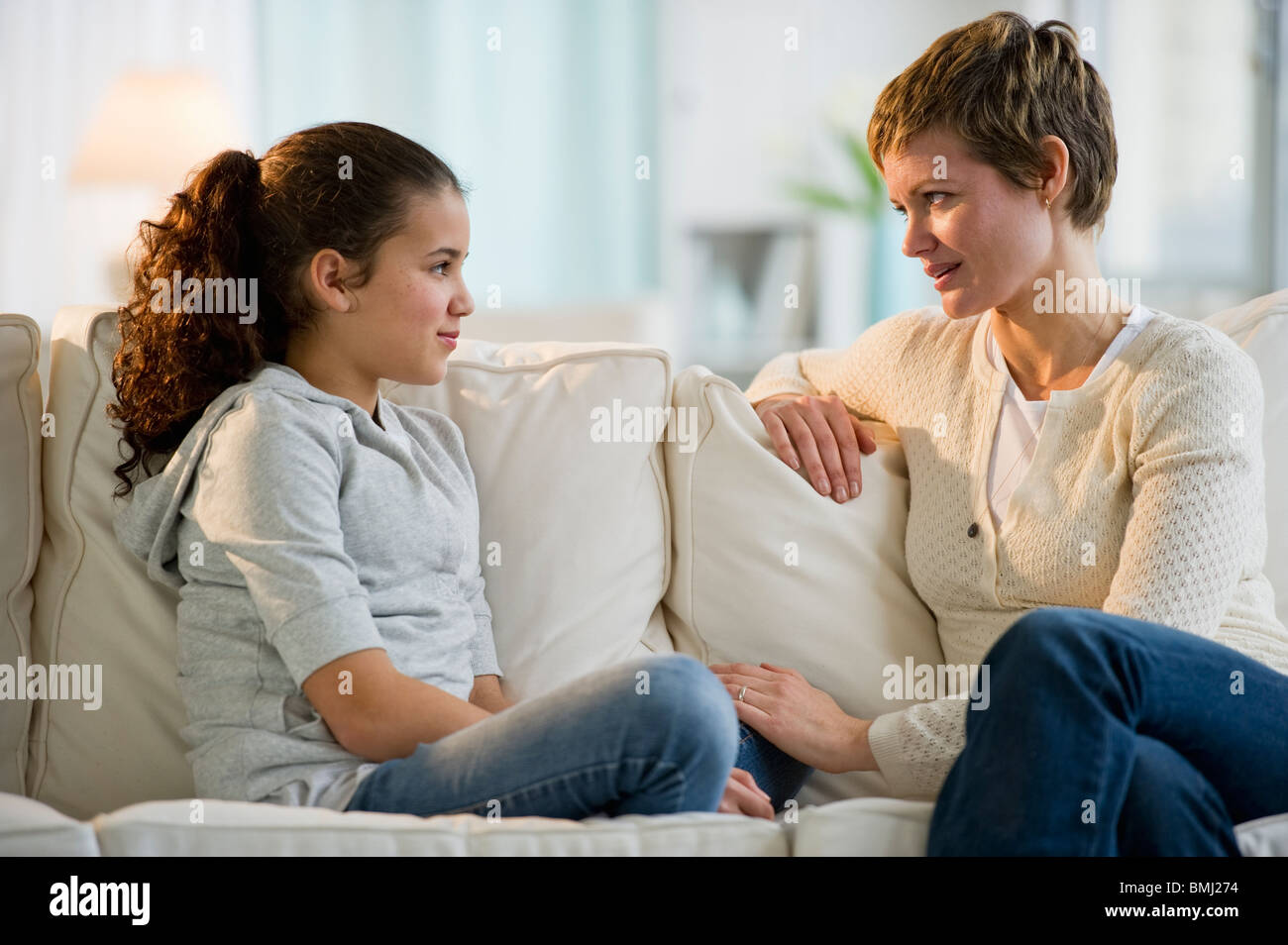 Mother and daughter having a serious talk - Stock Image