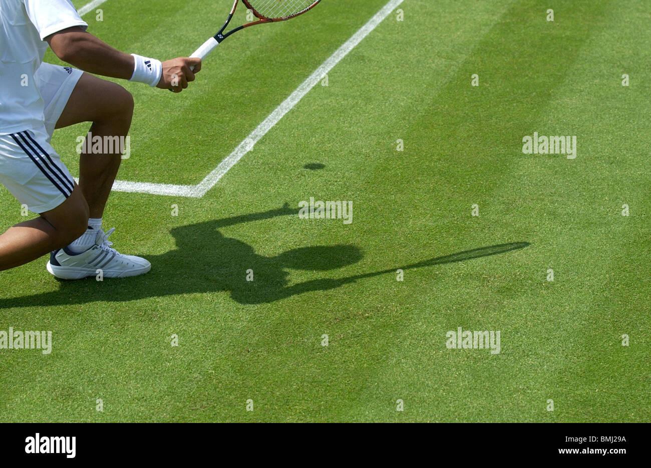 shadow of mens tennis player wimbledon - Stock Image