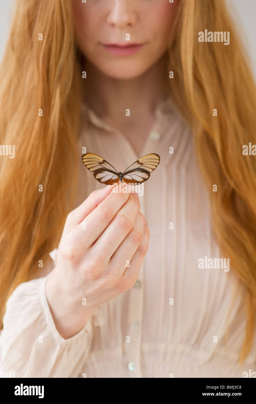 Woman holding butterfly - Stock Image