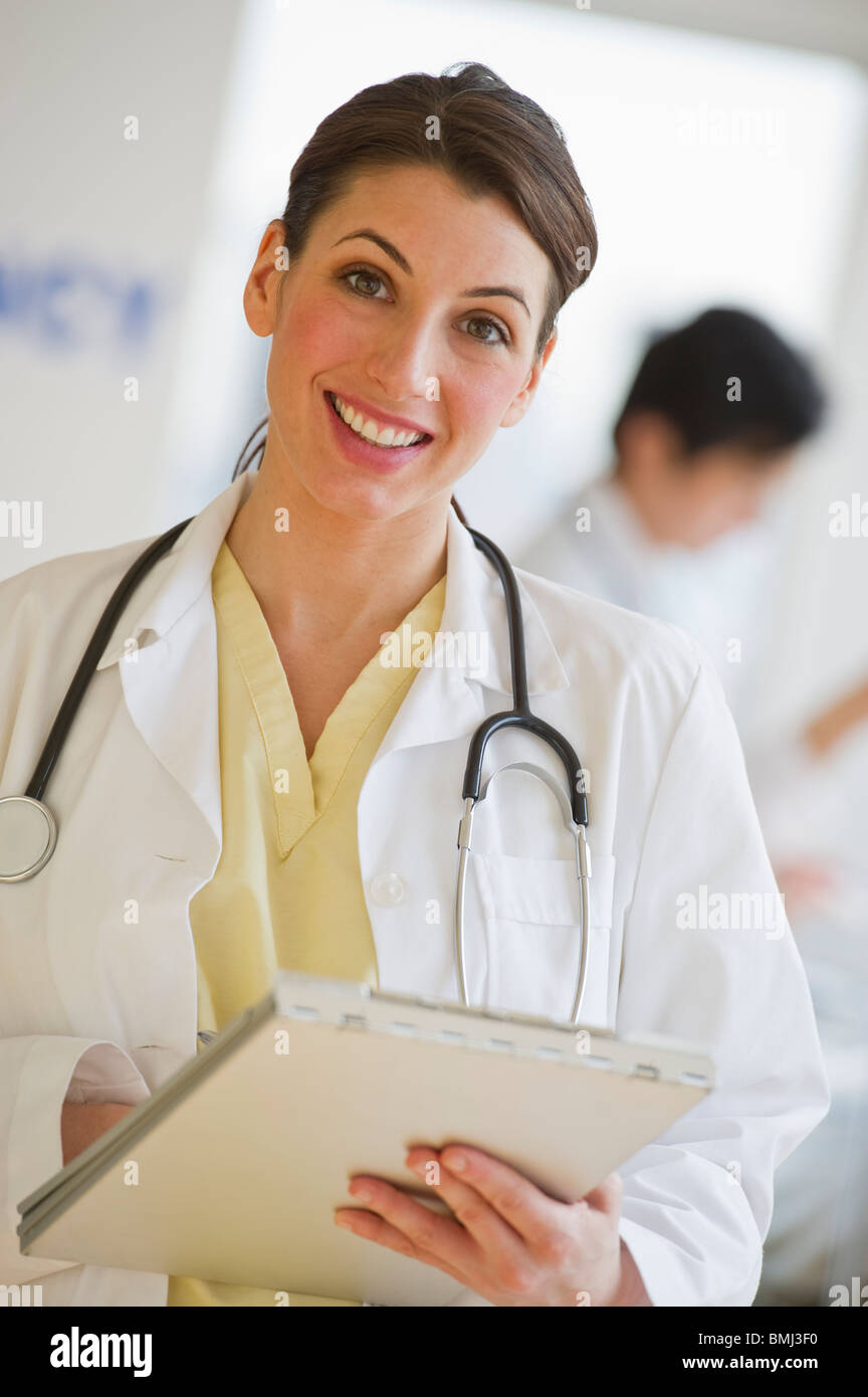 Doctor holding chart - Stock Image