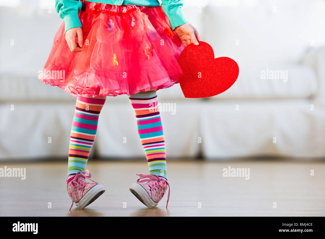 Young girl wearing colorful tights - Stock Image