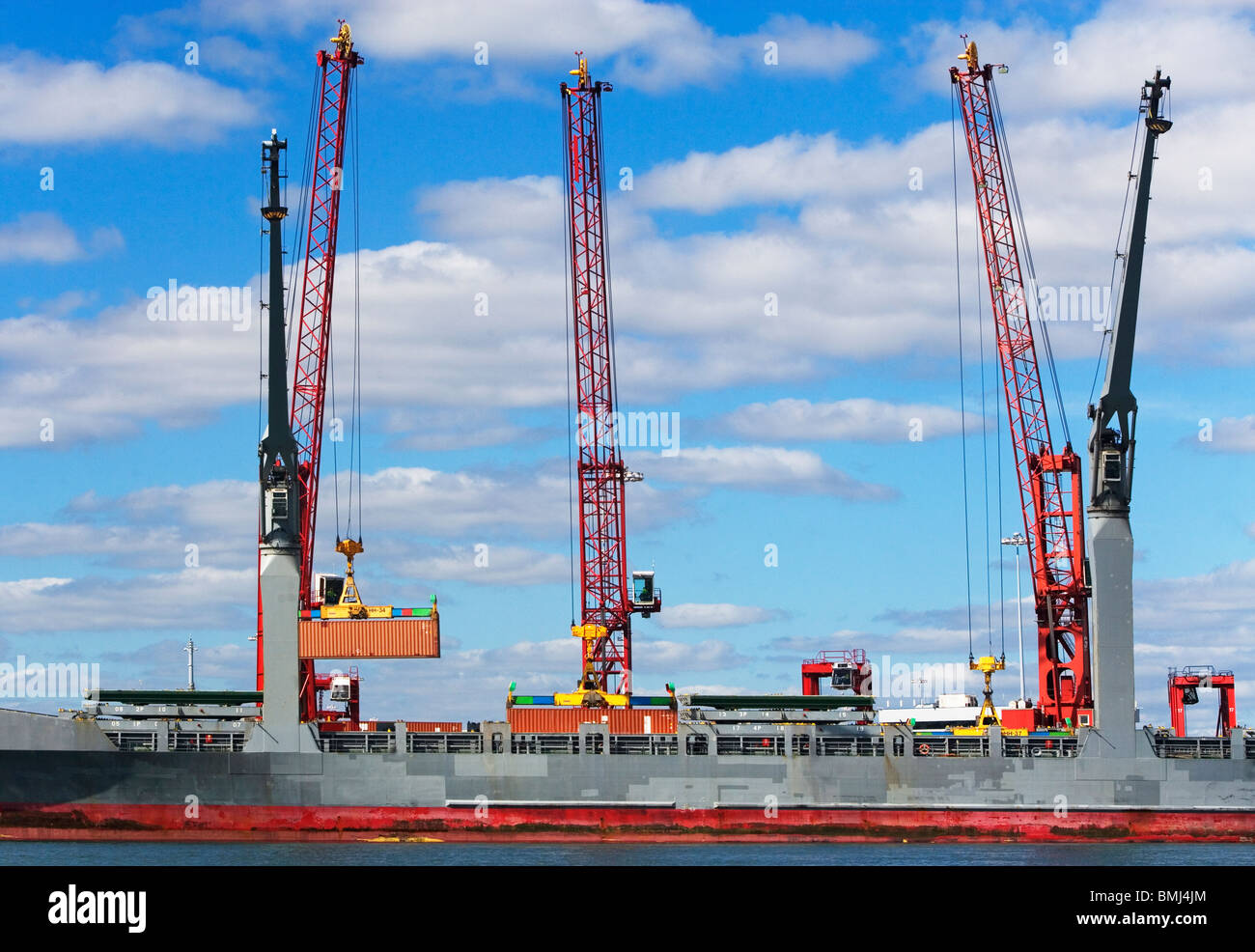 Cranes on cargo ship Stock Photo