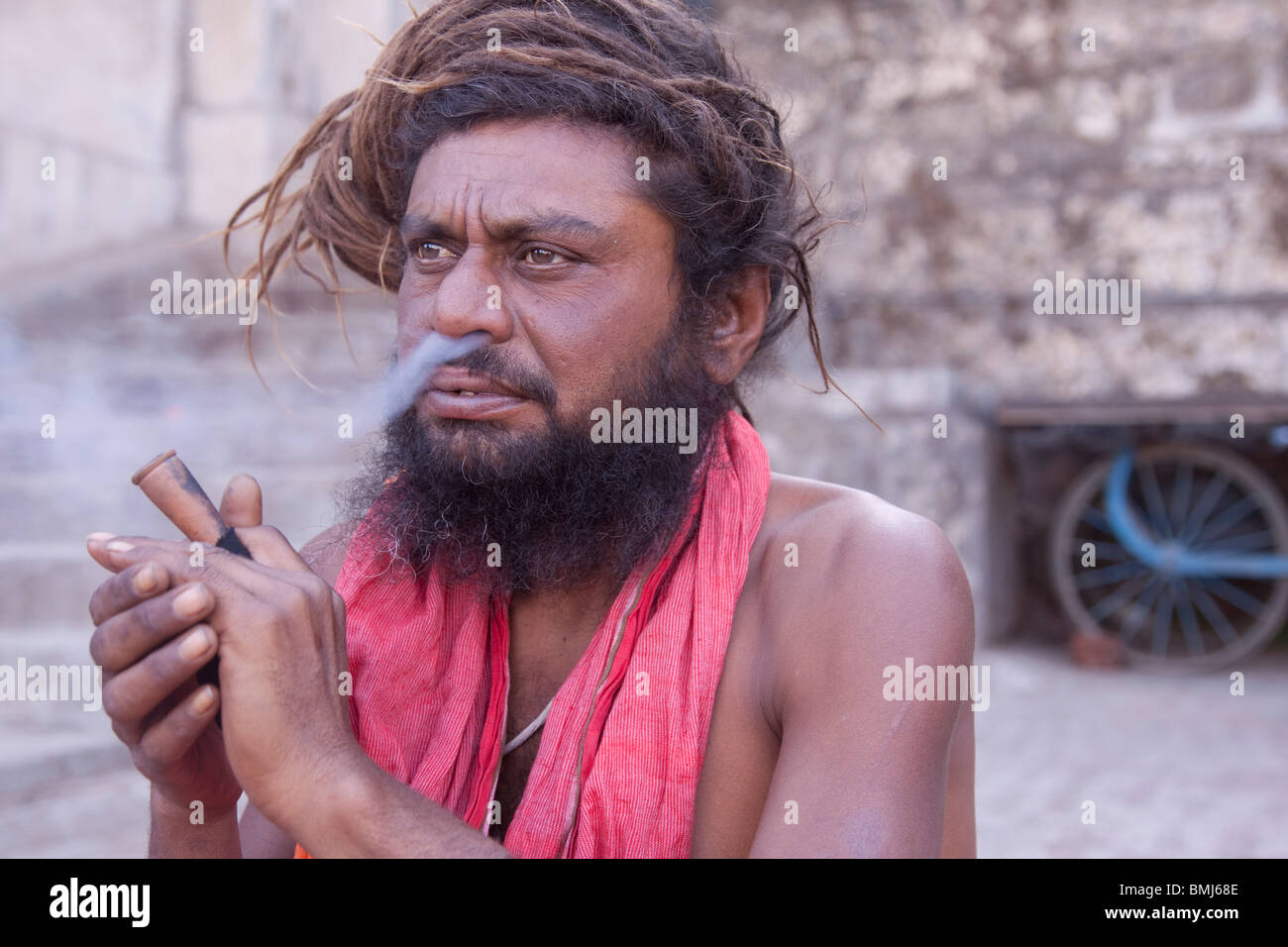 Sadhu smoking Charis (Hash) in Nasik India - Stock Image