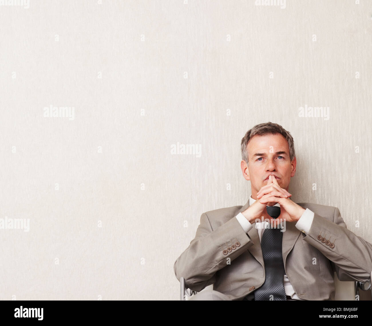 Businessman waiting - Stock Image