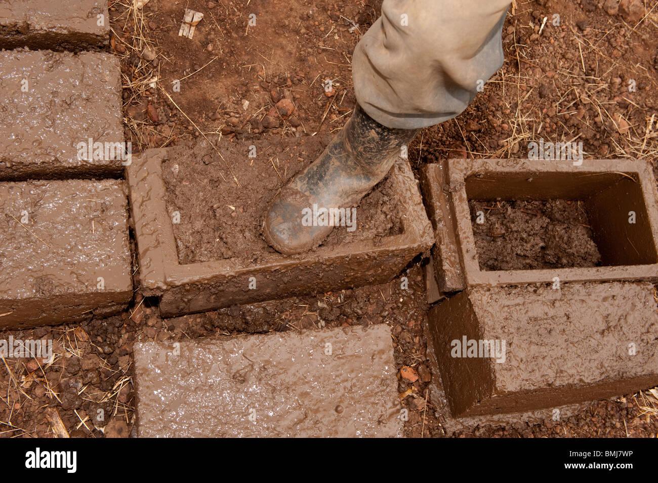Making bricks from mud. Rwanda - Stock Image