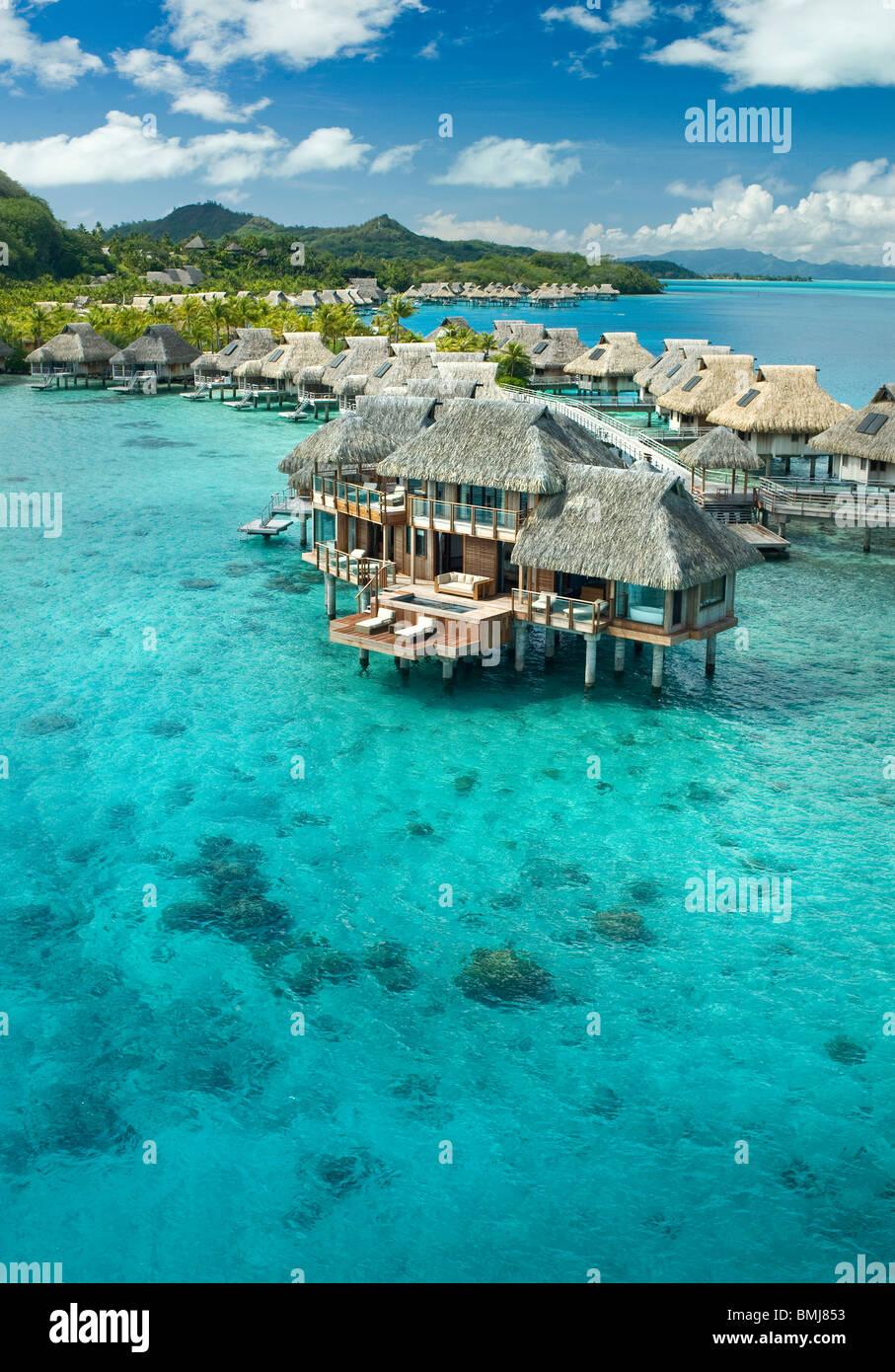 Overwater bungalows of Hilton bora Bora Nui Resort  hotel in Bora bora Island - Stock Image