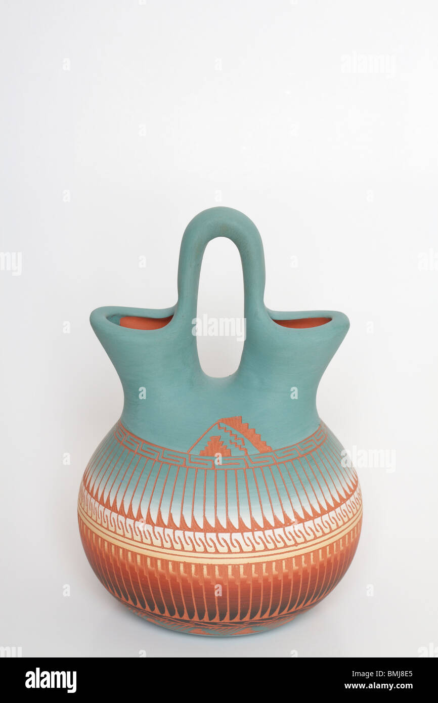 Green and terracotta Native America Indian Navajo Wedding Vase against a white background - Stock Image