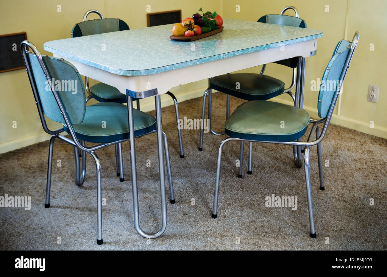 A modern dinner set table and chairs in a beach house from the fifties (u002750s house or 50u0027s house) Auckland New Zealand & A modern dinner set table and chairs in a beach house from the ...