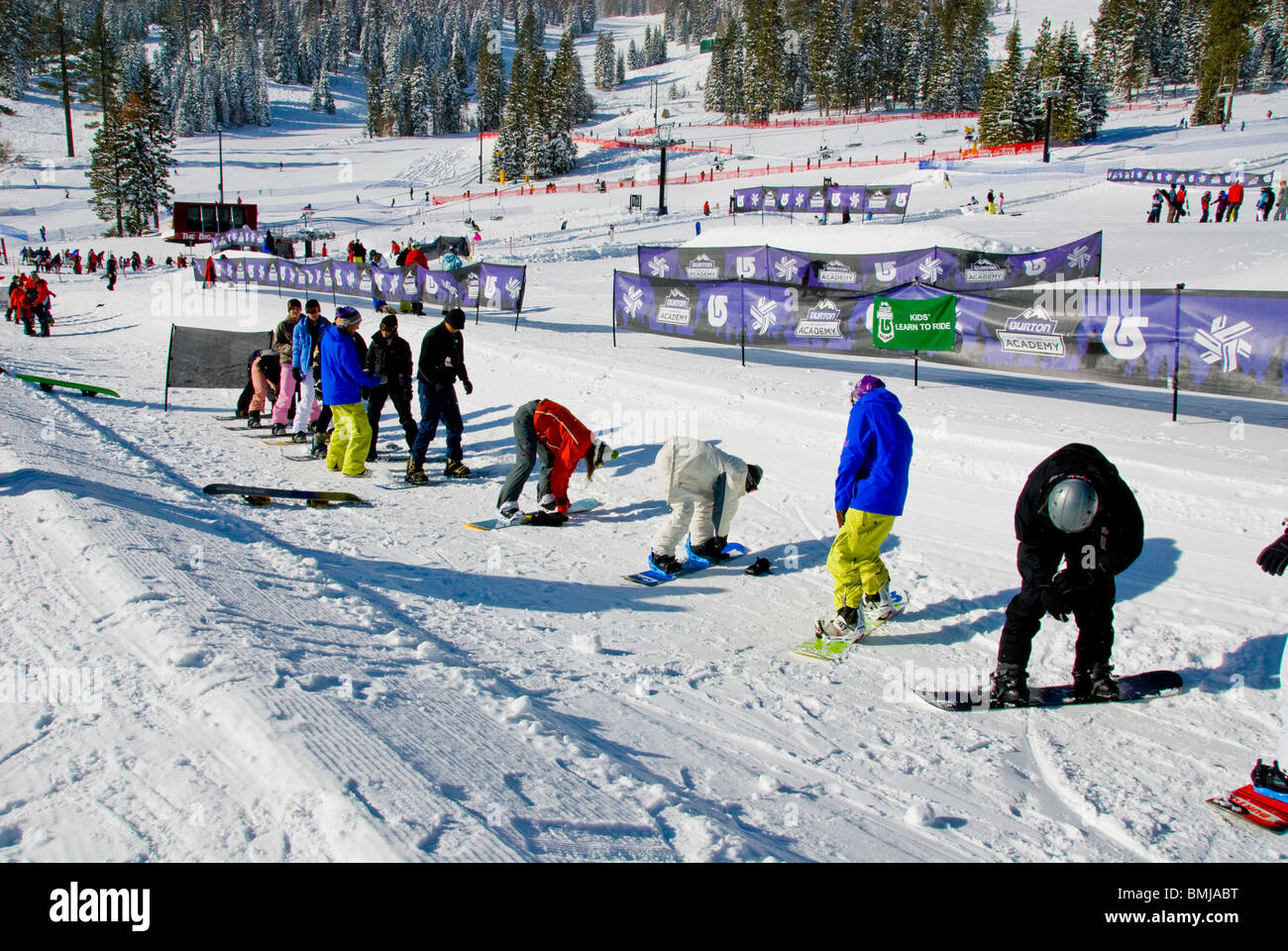 Winter scene Beginners ski and snowboard lessons snowboards skis Northstar Village Resort North Lake Tahoe California USA ice Stock Photo
