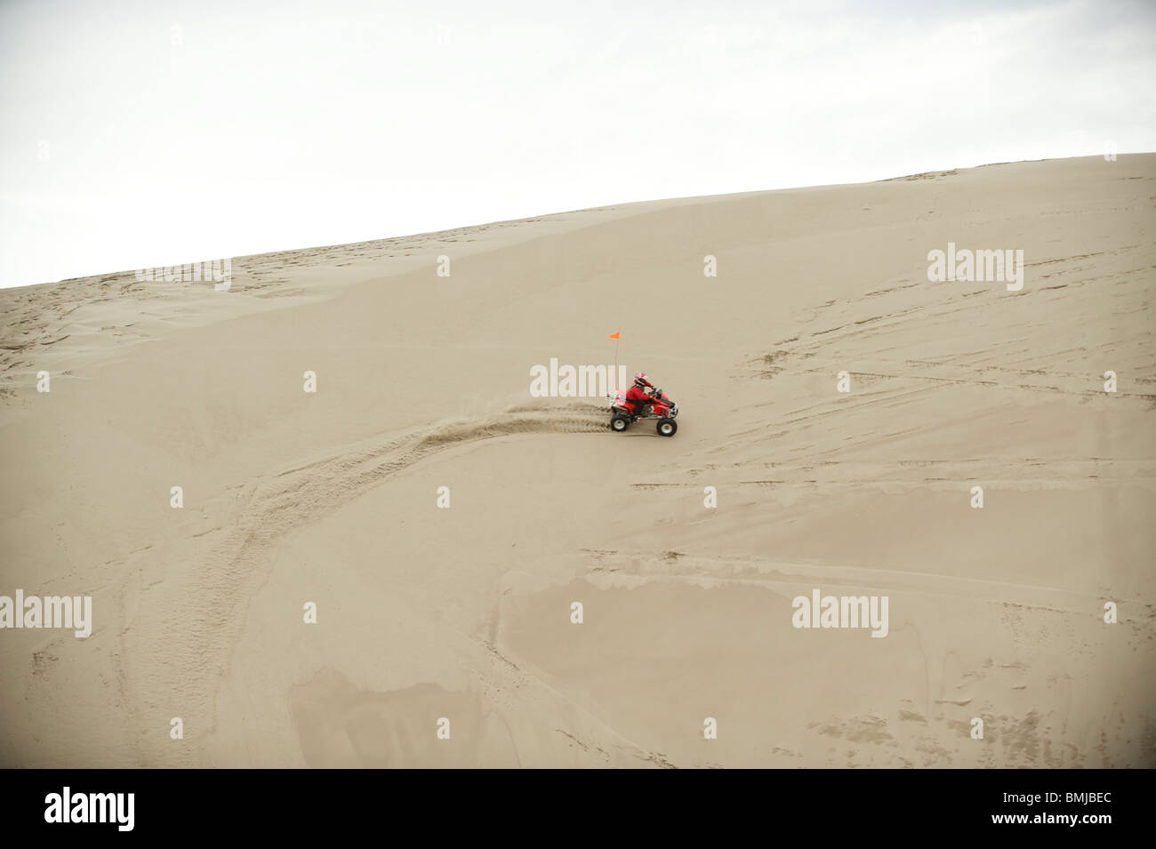 Dune buggies, quad bikes, ATCs and dirt bikes, ride through sand dunes in St. Anthony, Idaho, USA. - Stock Image