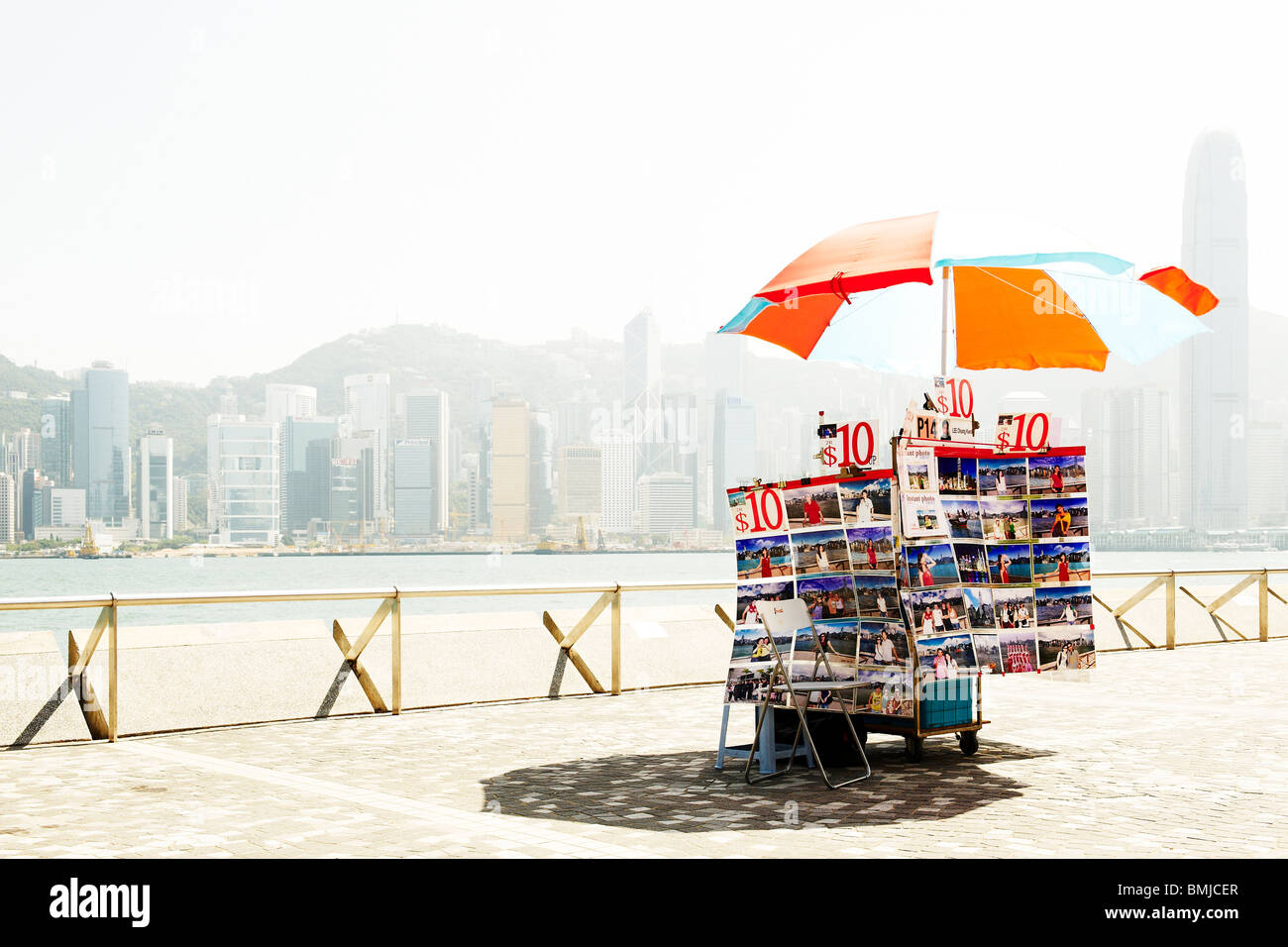 Instant photo cart stands unattended at waterfront of Hong Kong island, a rare sight at such a highly populated Stock Photo