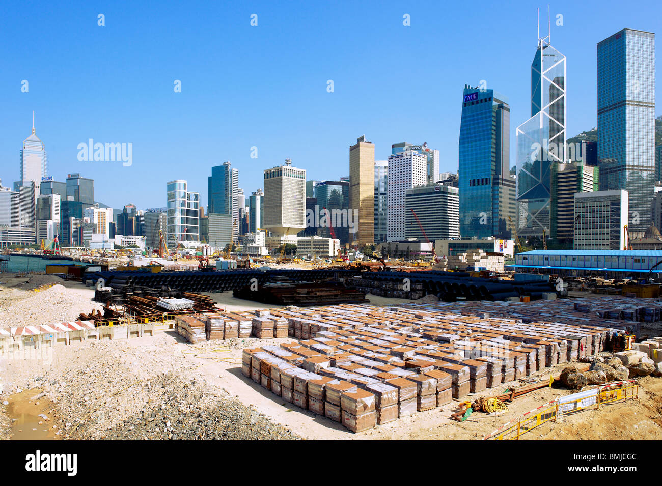 Construction goes on still in Hong Kong, despite the severe shortage of land, they have been reclaiming sea to continue - Stock Image