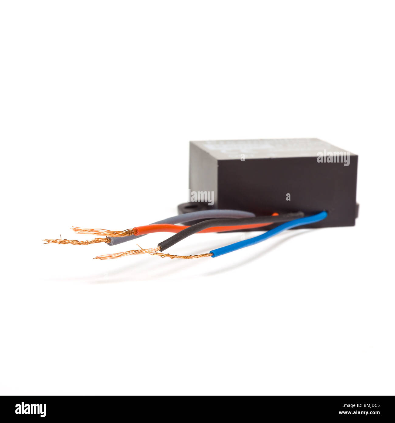 Black Box electronic gizmo with wires isolated against white background. - Stock Image