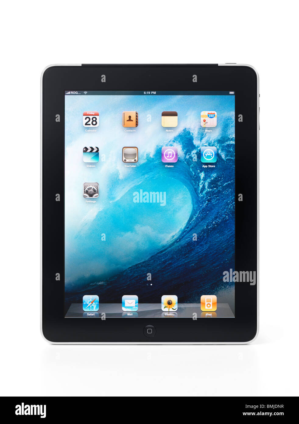 Apple iPad 3G tablet with desktop icons on its display isolated on white background with clipping path - Stock Image