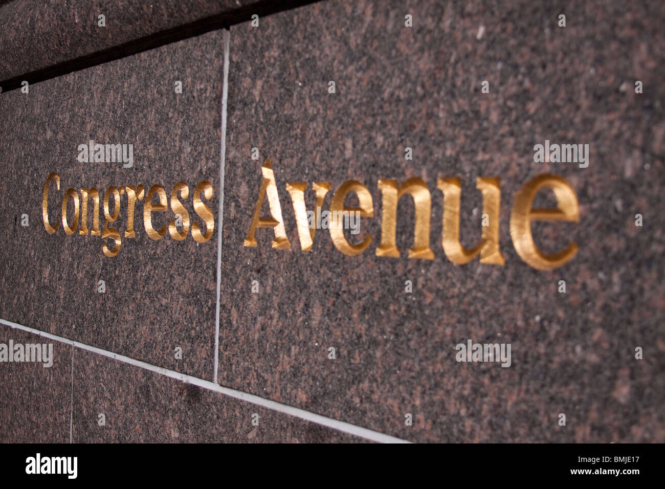 Congress Avenue sign embossed in gold into stone wall in Austin, Texas - Stock Image