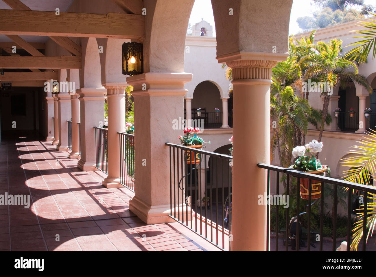 Arched columns along second story portico in Balboa Park visitor center courtyard - Stock Image