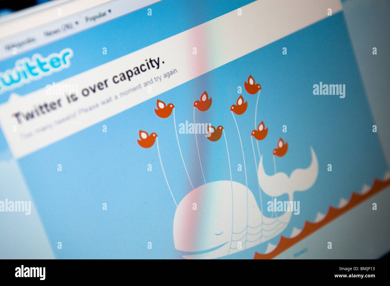 Close up of a computer monitor / screen showing the website Twitter over capacity due to too many people using it - Stock Image