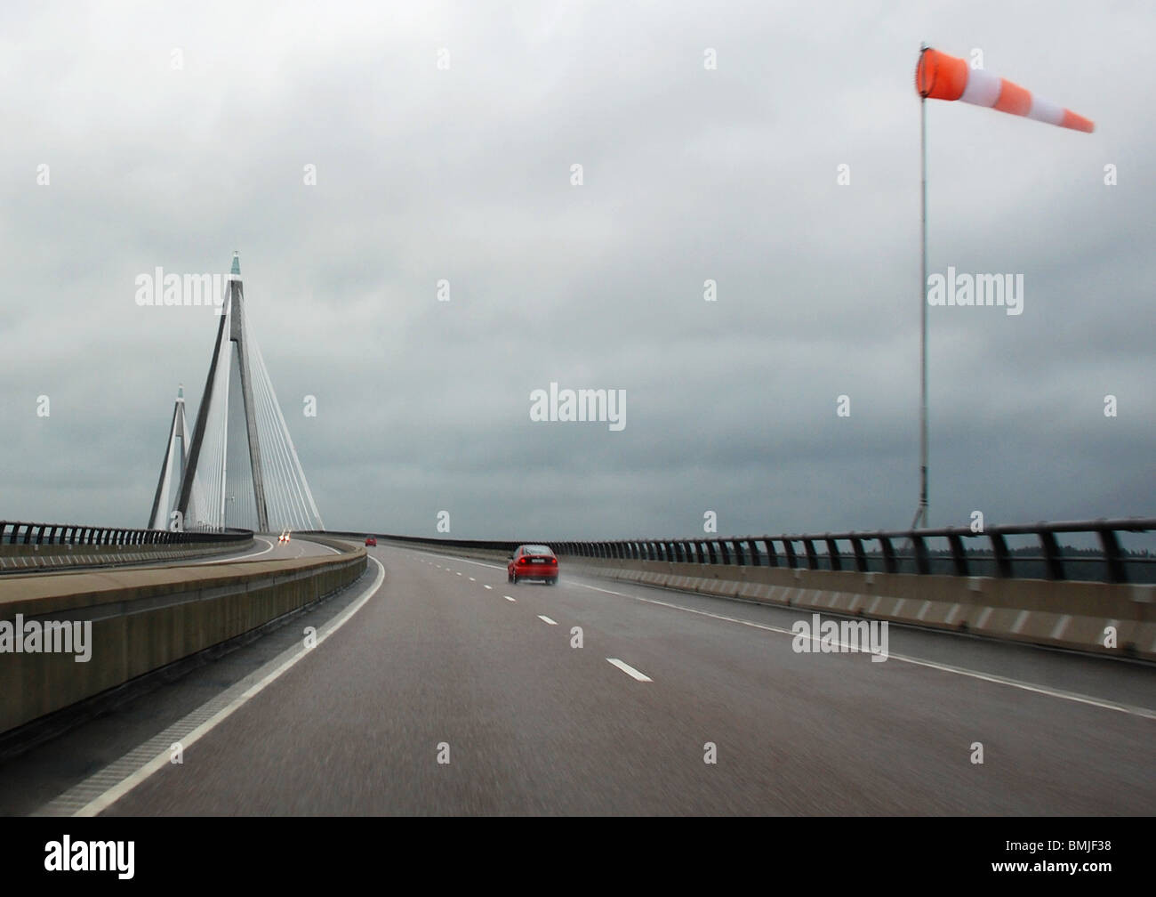 Direction of relative wind on road - Stock Image
