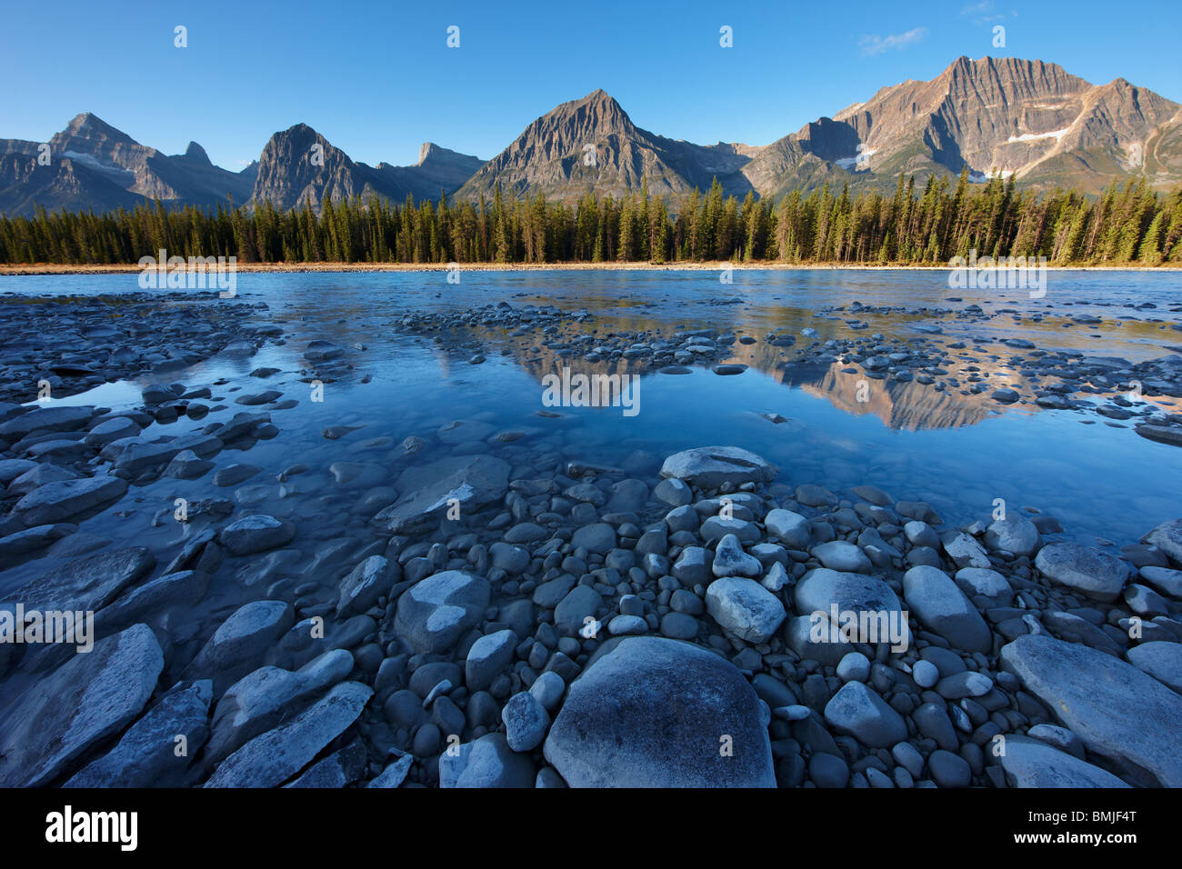 the Athabasca River with Mt Fryatt & Brussels Peak at dawn, Jasper National Park, Alberta, Canada - Stock Image