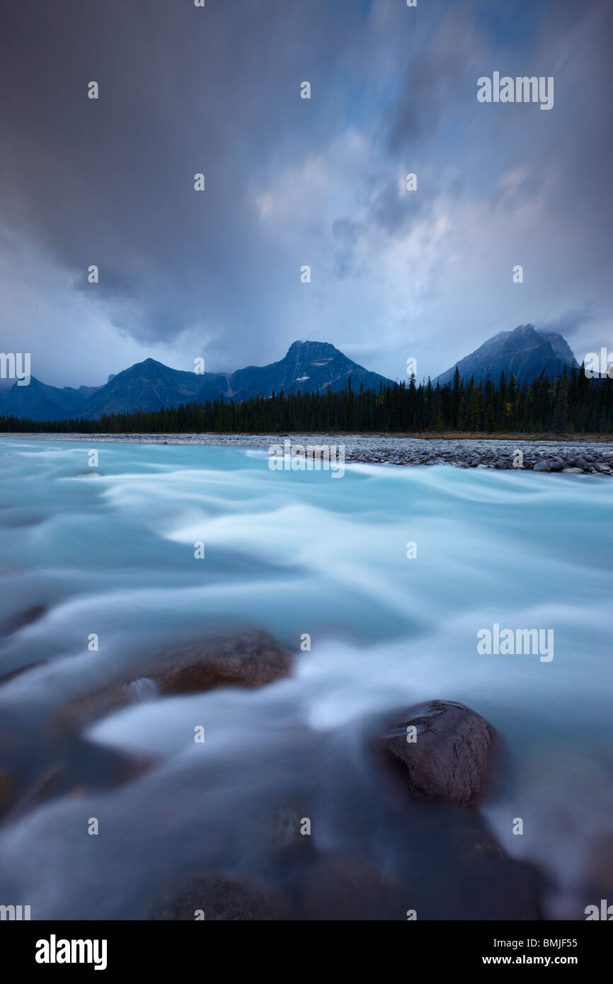 the Athabasca River with Dragon Peak and the Winston Churchill Range at dawn, Jasper National Park, Alberta, Canada - Stock Image