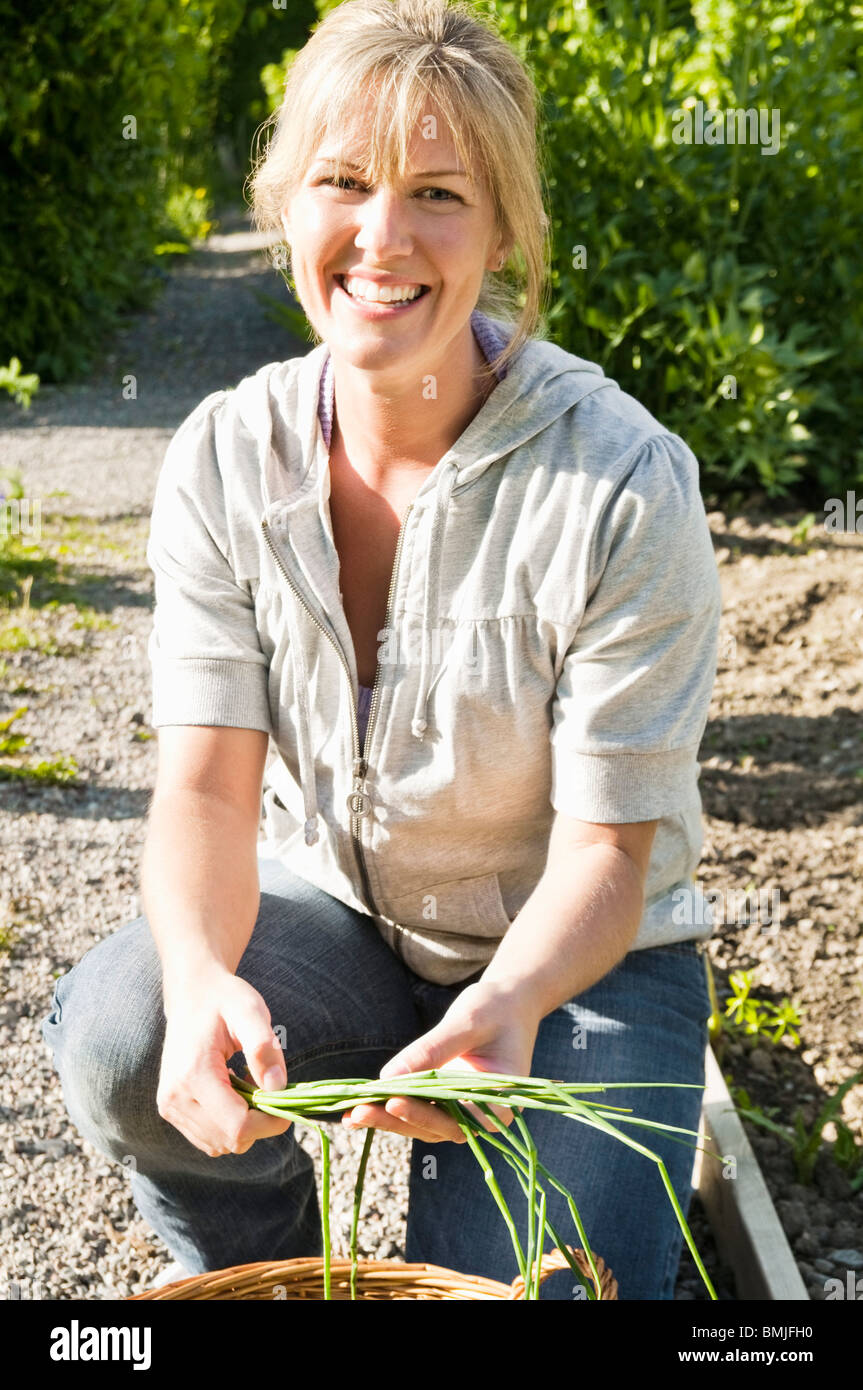 Woman with chive - Stock Image