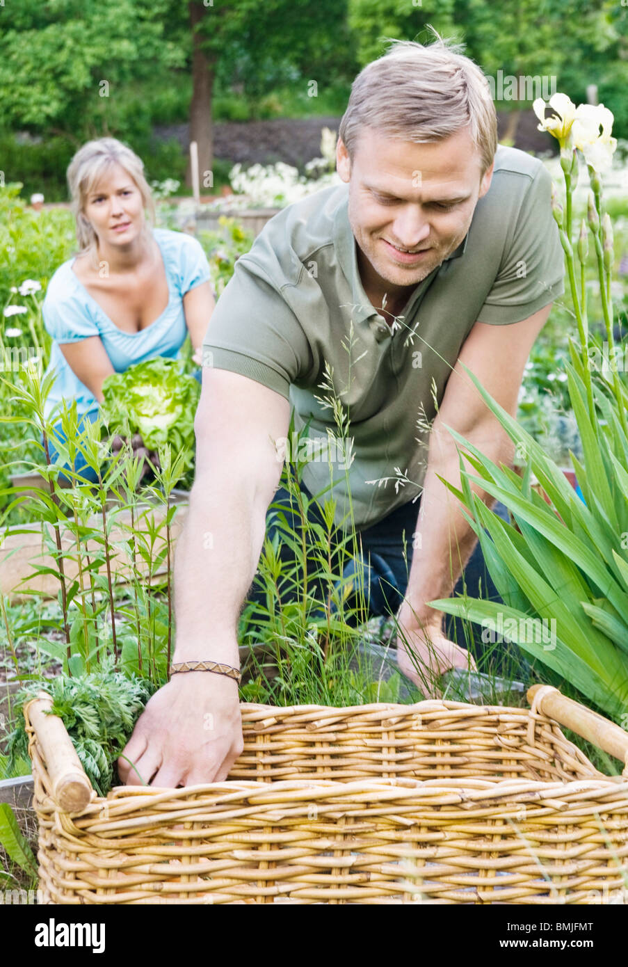 Couple taking care of garden - Stock Image