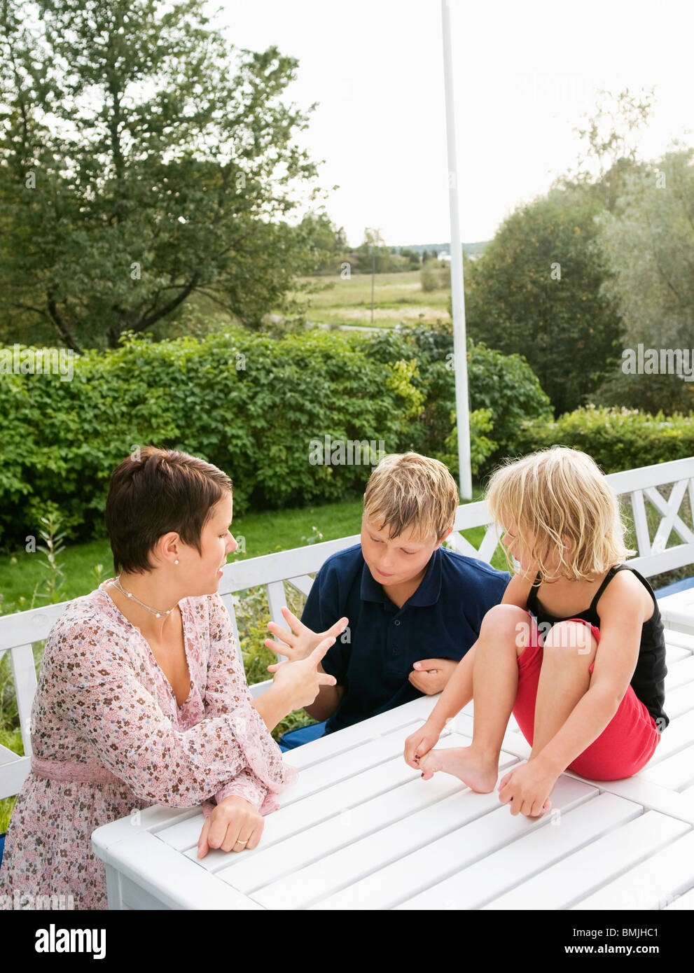 Family sitting outside - Stock Image