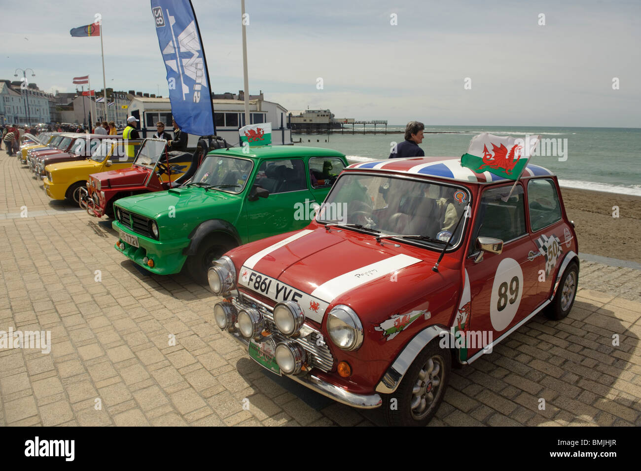 Mini car owners rally group meeting on Aberystwyth seafront promenade, Wales UK - Stock Image