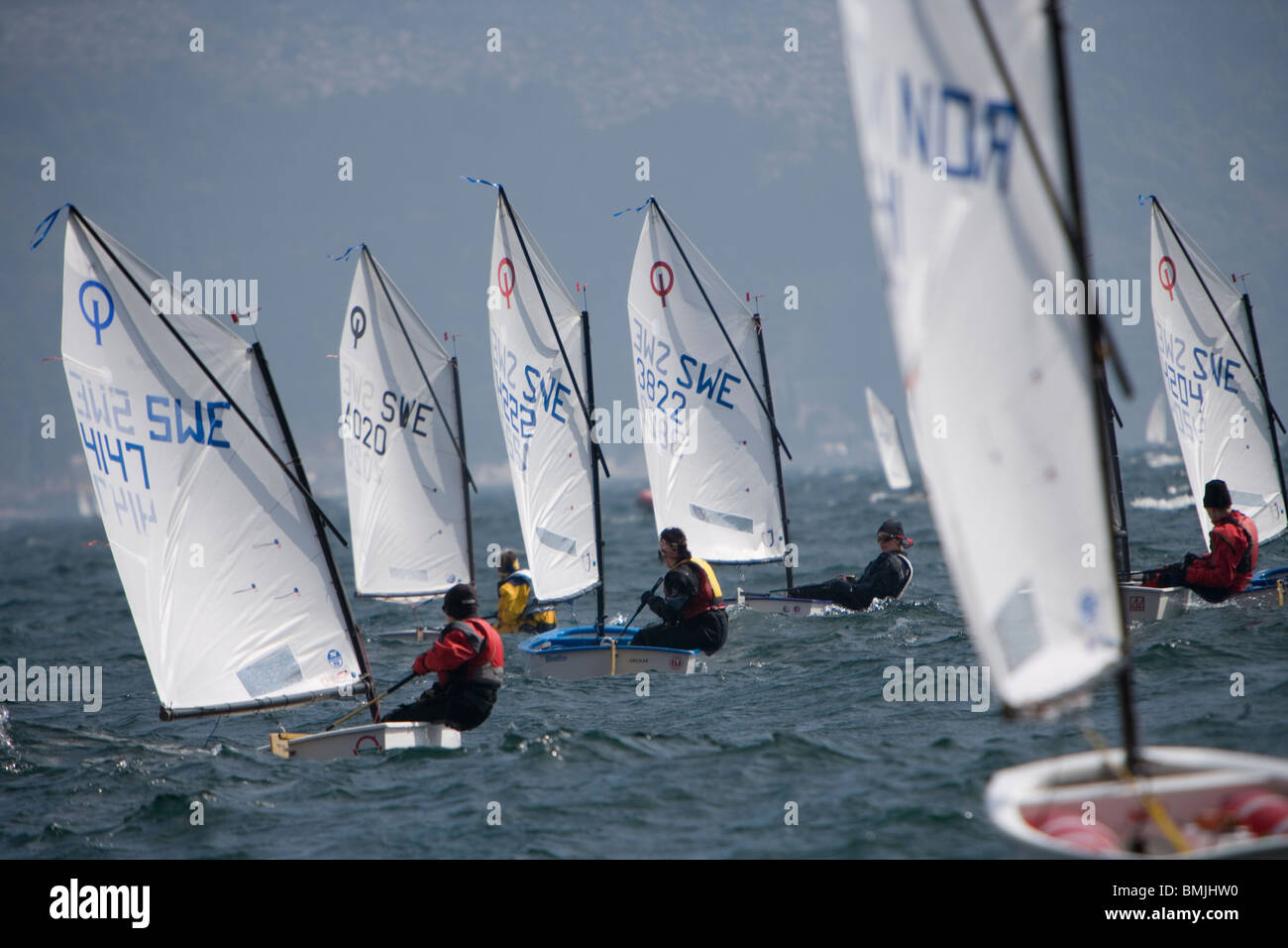 View of sail boat racing in lake - Stock Image