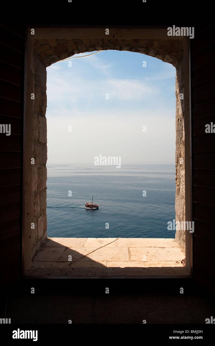 View of the Adriatic Sea, through a portal in the Lovrijenac Fortress, Dubrovnik, Croatia, Europe - Stock Image