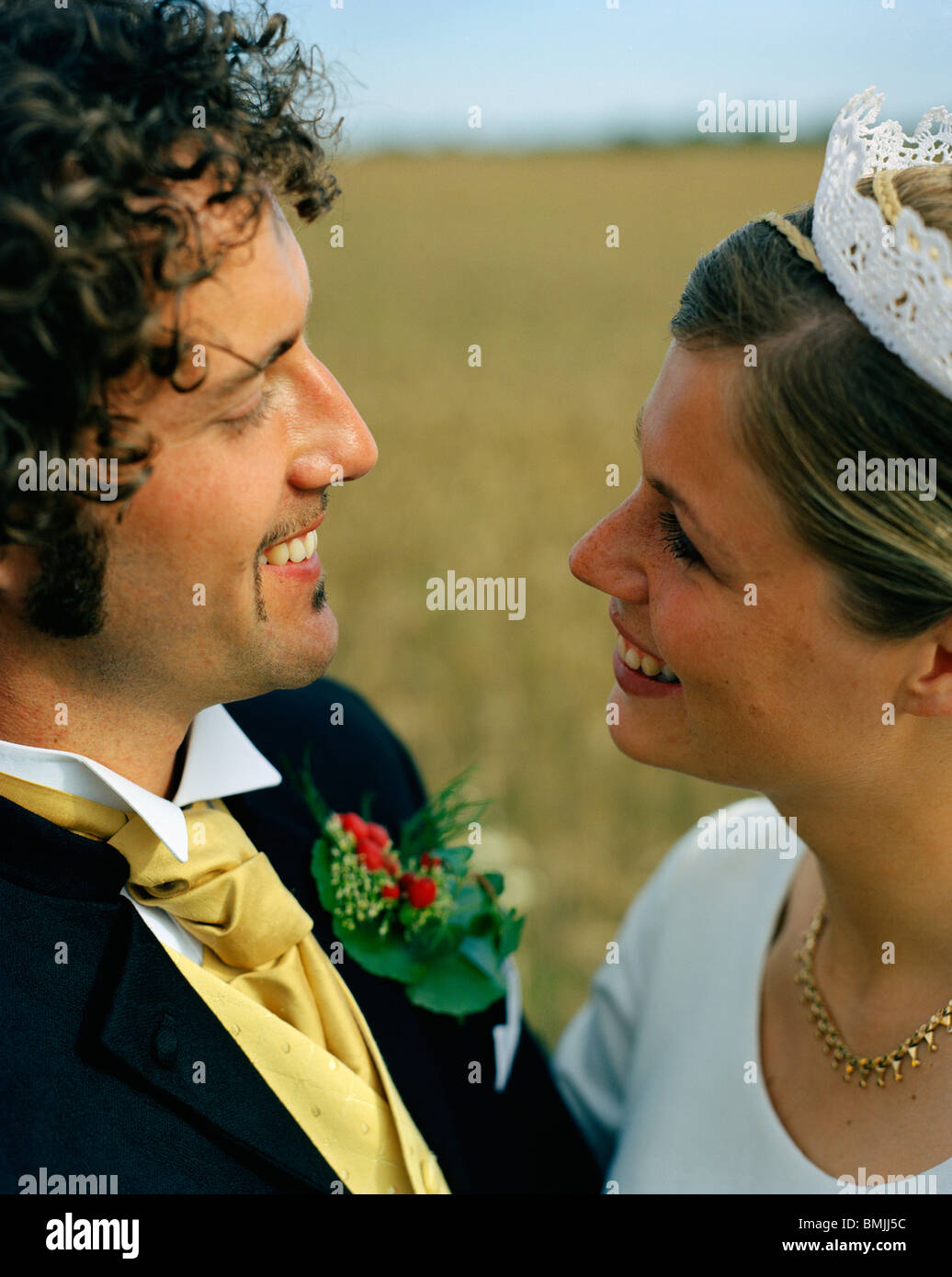 Scandinavia, Sweden, Oland, Bride and groom smiling at each other, close-up Stock Photo