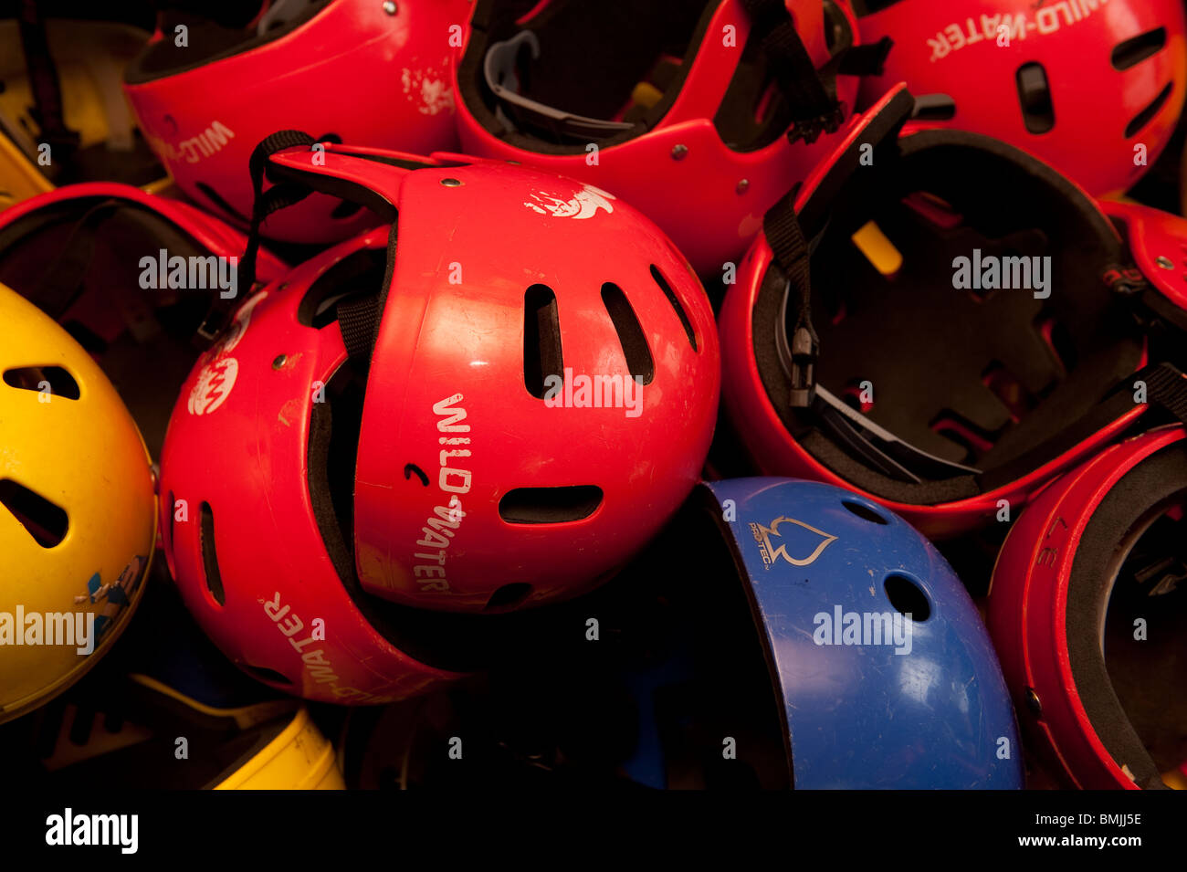 Helmets, Safety equipment at The Urdd outward bound activity Centre, Glanllyn, Bala lake, Gwynedd North Wales UK - Stock Image
