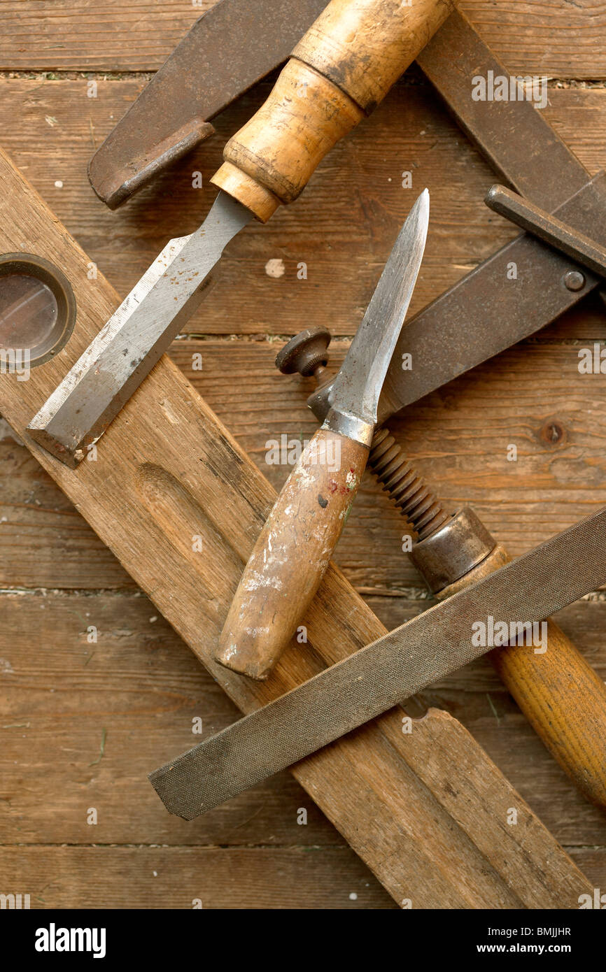 View of various carpenter tools against wood, elevated view - Stock Image