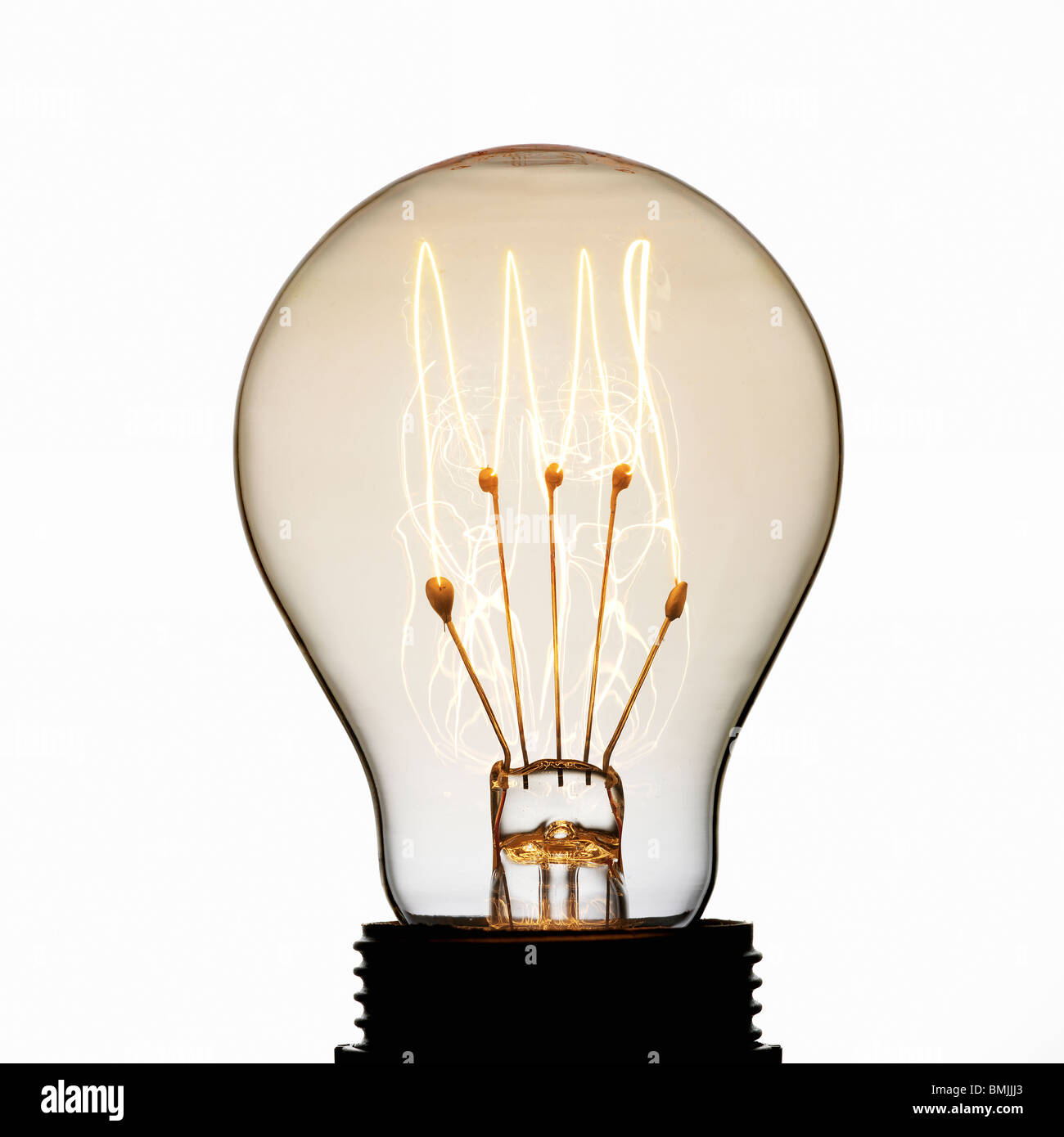 View of electric bulb against white background - Stock Image